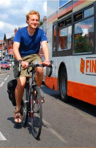 Cyclist alongside bus