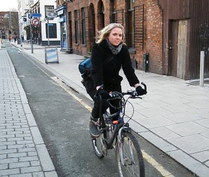 Anne Berg riding in cycle lane in Manchester