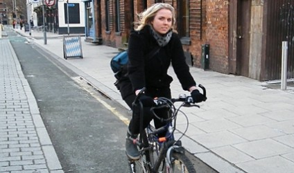 Anne Berg cycling in Manchester