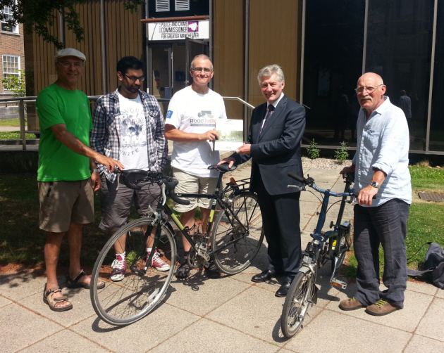 Cyclists handing the CTC Road Justice report to GMPCC Tony Lloyd
